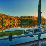 House over Lake Logan with outdoor bar and view of lake in Hocking Hills